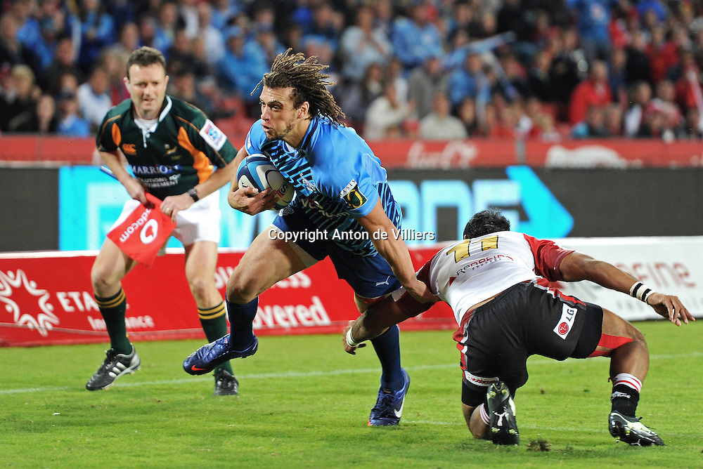 JOHANNESBURG, South Africa, 14 April 2012. Zane Kirchner of the Bulls gets away from James Kamana of the Lions for his try during the Super15 Rugby match between the Lions and the Bulls at Coca-Cola Park in Johannesburg, South Africa on 14 April 2012. The Bulls won this away game 32-18.<br /> Photographer : Anton de Villiers / SASPA