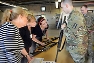 From left, Joanne Gianandrea, of Ocean City, New Jersey, Joanna Graham of Mt. Laurel, New Jersey and Anna D'Anna of West Windsor, New Jersey are shown some military issue rifles by a soldier during an Honorary Commander boot camp for 40 local officials Thursday October 29, 2015 at Joint Base McGuire-Dix-Lakehurst  in Fort Dix, New Jersey. Participants experienced combined arms training, simulated combat environments and enjoyed a military cuisine. (Photo by William Thomas Cain)