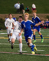 Hopkinton's Owen Kanter and Gilford's Bryce Workman charge the ball during NHIAA Division III semi final at LHS turf field Wednesday evening.  (Karen Bobotas/for the Laconia Daily Sun)