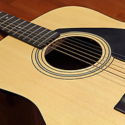 An acoustic guitar at rest.
