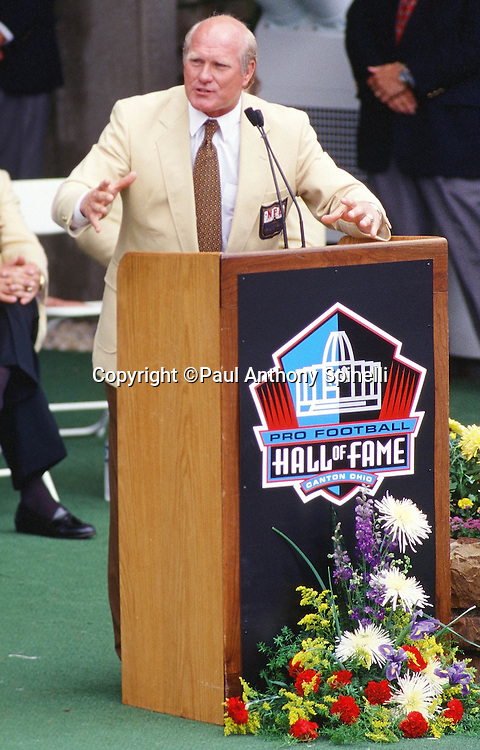 Former Pittsburgh Steelers quarterback Terry Bradshaw smiles as he speaks at the podium during his Pro Football Hall of Fame Induction speech before the Minnesota Vikings NFL football game against the Seattle Seahawks on July 26, 1997 in Canton, Ohio. The Vikings won the game 28-26. (©Paul Anthony Spinelli)