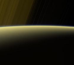 Jul 27, 2017 - Space - This false-color view from NASA's Cassini spacecraft gazes toward the rings beyond Saturn's sunlit horizon. Along the limb (the planet's edge) at left can be seen a thin, detached haze. Cassini will pass through Saturn's upper atmosphere during the final five orbits of the mission, before making a fateful plunge into Saturn on Sept. 15, 2017. When Cassini plunges toward Saturn to meet its fate, contact with the spacecraft is expected to be lost before it reaches the depth of this haze. This view is a false-color composite made on July 16, 2017, at a distance of about 777,000 miles from Saturn. (Credit Image: © NASA/JPL-Caltech/ZUMA Wire/ZUMAPRESS.com)
