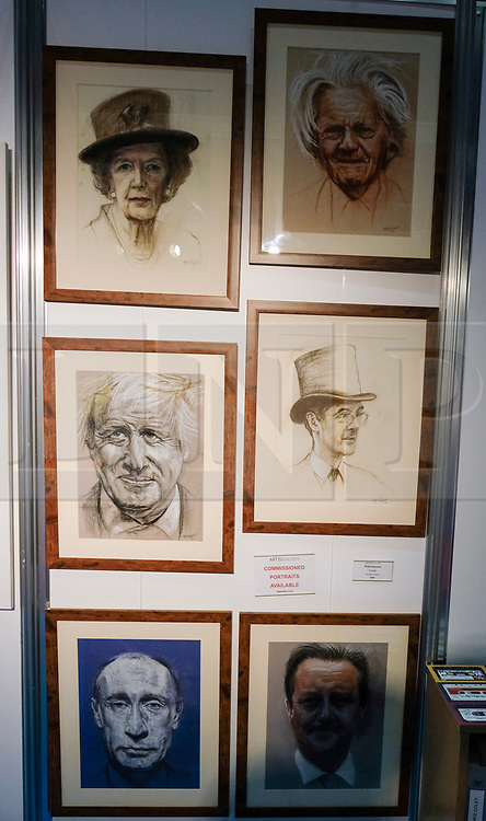 (c) Licensed to London News Pictures. <br /> 02/10/2017<br /> Manchester, UK<br /> <br /> Art work depicting prominent party members is displayed at a stall at the Conservative Party Conference held over four days at the Manchester Central Convention Complex.<br /> <br /> Photo Credit: Ian Forsyth/LNP