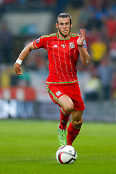 Gareth Bale of Wales (Real Madrid) in action - Photo mandatory by-line: Rogan Thomson/JMP - 07966 386802 - 12/06/2015 - SPORT - FOOTBALL - Cardiff, Wales - Cardiff City Stadium - Wales v Belgium - EURO 2016 Qualifier.