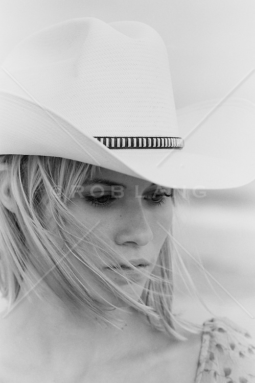 Portrait of a girl in a white cowboy hat