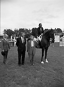 "08/08/1987<br /> 08/08/1987<br /> 08 August 1987<br /> RDS Horse Show, Ballsbridge, Dublin. The Guinness Championship Tankards. Sylvia Bodell, wife of Ernest Bodell (2nd left) Director of Guinness Ireland, presenting the Guinness Championship Gold Tankard for the leading international rider of the Dublin Horse Show 1987, to Eddie Macken (Ireland) on ""Carroll's Flight"". Also in the picture is Colonel Billy Ringrose, Chairman, Equestrian Committee, RDS."