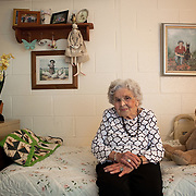 NURSING HOME<br /> <br /> Alice Jacobs, 90, is shown in her room at the Dogwood Village assisted living facility Friday, June 23, 2017, in Orange, VA.  Jacobs once owned a factory and horses, raised four children and buried two husbands.  But years in an assisted living facility drained her savings, and now, she relies on Medicaid to pay for her care.  Painting at right is of Ms. Jacobs and her dog.<br /> <br /> Photo by Khue Bui