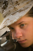 Marine Corps recruit Rebecca Pasko looks down her weapon's sites during training at Parris Island, S.C., on Nov. 24, 2007. (Photo by Stacy L. Pearsall)