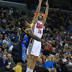 28 January 2009: New Orleans Hornets forward Peja Stojakovic (16) shoots over Denver Nuggets guard J.R. Smith (1) during a 94-81 win by the New Orleans Hornets over the Denver Nuggets at the New Orleans Arena in New Orleans, LA. The Hornets wore special throwback uniforms of the former ABA franchise the New Orleans Buccaneers for the game as they honored the Bucs franchise as a part of the NBA's Hardwood Classics series. .