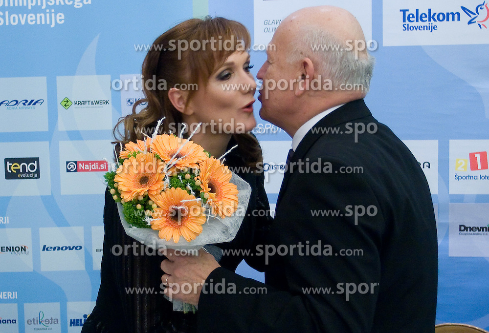 Petra Majdic is getting flowers from Janez Kocijancic of OKS for her birthday at press conference when she has signed a contract with IOC and OKS for 16 months long sponsorship (1500 $ monthly) till Olympic games in Vancouver 2010, on December 22, 2008, Grand hotel Union, Ljubljana, Slovenia. (Photo by Vid Ponikvar / SportIda).