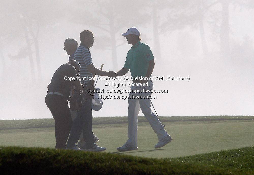 Feb 15 2015: A light fog rolls in as Nick Watney (left) congratulates winner Brandt Snedeker (right) after the final round of the AT&T Pebble Beach National Pro-Am in Pebble Beach, CA.