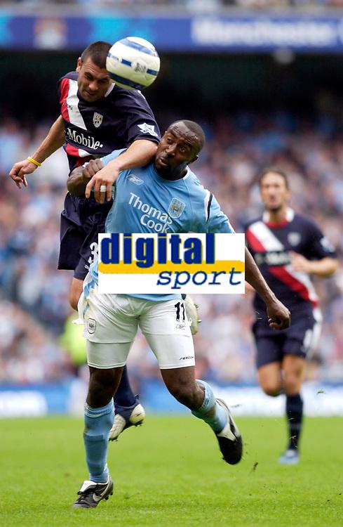 Photo: Daniel Hambury.<br /> Manchester City v West Bromich Albion. Barclaycard Premiership. 13/08/2005.<br /> Manchester City's Darius Vassell battles with  West Brom's Paul Robinson.