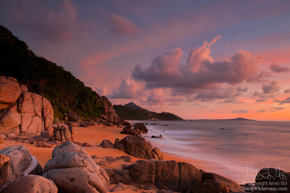 The setting sun reddens the rocky coastline south of Sayulita, Mexico. Monkey Mountain is the tall peak near the center of the image.
