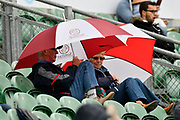 Umbrellas go up as the rain begins to fall during the Specsavers County Champ Div 1 match between Somerset County Cricket Club and Middlesex County Cricket Club at the Cooper Associates County Ground, Taunton, United Kingdom on 27 September 2017. Photo by Graham Hunt.