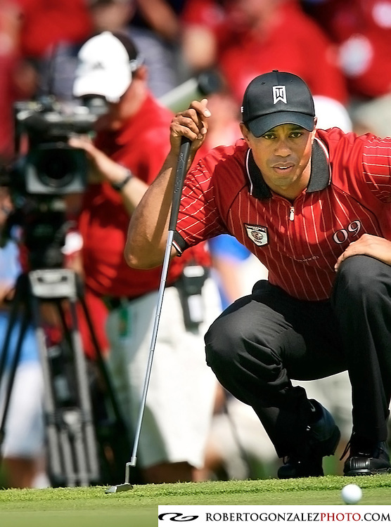 A camera follows Tiger Woods as he lines up a shot during the 2009 Tavistock Cup at Lake Nona Country Club in Orlando Florida, Monday, March 16, 2009. The golf tournament matches Isleworth Country Club golfers against Lake Nona golfers.