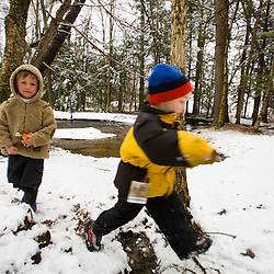 Young boys play in a spring snow in Barrington, New Hampshire.