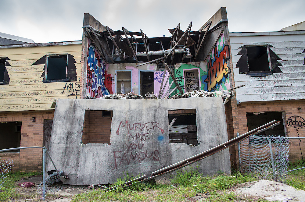 Graffiti on the remains of one of the apartments in Press Park, a low income housing unit left in ruin since Hurricane Katrina.