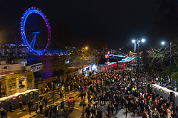 © Licensed to London News Pictures. 01/01/2018. London, UK. Revellers go home after seeing a spectacular fireworks display lighting up the London skyline just after midnight on January 1, 2018 in central London as part of the capitals New Year's Eve celebrations. Thousands of people lined the banks of the River Thames in London to see in the New Year. Photo credit: Ray Tang/LNP