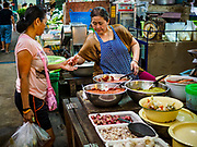 07 NOVEMBER 2017 - BANGKOK, THAILAND: A woman selling curry paste at a local market on Ekkamai Soi 30 in Bangkok.      PHOTO BY JACK KURTZ