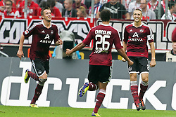 11.09.2011,  Rhein Energie Stadion, Koeln, GER, 1.FBL, 1. FC Koeln vs 1. FC Nürnberg, im Bild.Torjubel / Jubel  nach dem 0:2 durch Timmy Simons (Nuernberg #2) (R) mit Timothy Chandler (Nuernberg #26) und Tomas Pekhart (Nuernberg #9) (L)..// during the 1.FBL, 1. FC Koeln vs 1. FC Nürnberg on 2011/09/11, Rhein-Energie Stadion, Köln, Germany. EXPA Pictures © 2011, PhotoCredit: EXPA/ nph/  Mueller *** Local Caption ***       ****** out of GER / CRO  / BEL ******