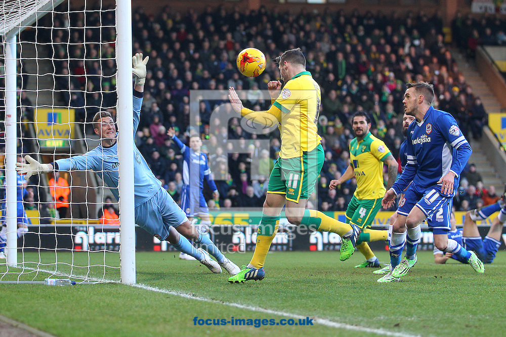 Gary Hooper of Norwich scores his sides 1st goal during the Sky Bet Championship match at Carrow Road, Norwich<br /> Picture by Paul Chesterton/Focus Images Ltd +44 7904 640267<br /> 17/01/2015