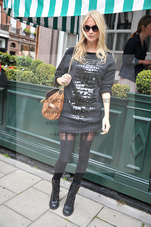 POPPY DELEVINGNE at a lunch to celebrate the the Lulu & Co Autumn/Winter 2011 collection held at Harry's Bar, 26 South Audley Street, London W1 on 21st June 2011.