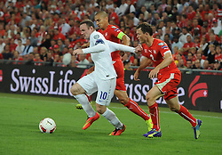 England captain, Wayne Rooney (Manchester United) battles for the ball with  - Photo mandatory by-line: Joe Meredith/JMP - Mobile: 07966 386802 - 08/09/14 - SPORT - FOOTBALL - Switzerland - Basel - St Jacob Park - Switzerland v England - Uefa Euro 2016 Group E Qualifier