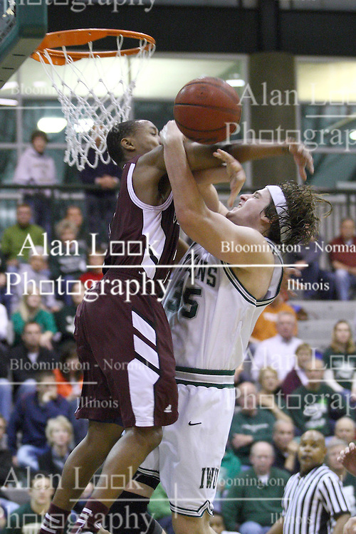 15 December 2012:  Andrew Ziemnik guarded by Royce Muskeyvalley during an NCAA mens division 3 basketball game between theUniversity of Chicago Maroons and the Illinois Wesleyan Titans in Shirk Center, Bloomington IL