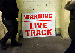 "© Licensed to London News Pictures. 02/12/2012. London, UK A sign saying 'Warning - Live Track"" leans against a wall. London Transport Museum held tours, today 2nd December 2012, of Aldwych Tube Station, one of London's closed underground stations. Visitors were give a rare chance to glimpse what happens to a station after the public leave. The tour included a platform closed in 1914 which was used as a store for the National Gallery during the 2nd World War, amongst items stored were the Elgin Marbles. The station was used by 1000's of Londoners during the blitz as an air raid shelter. The station is often used for filming with films such as Atonement, V for Vendetta, Superman 4 and 28 weeks later. Photo credit : Stephen Simpson/LNP"
