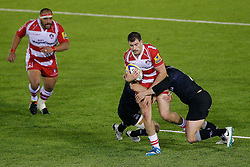 Gloucester Inside Centre Mark Atkinson is tackled by Newcastle Flanker Andy Saull - Photo mandatory by-line: Rogan Thomson/JMP - 07966 386802 - 21/11/2014 - SPORT - RUGBY UNION - Newcastle upon Tyne, England - Kingston Park - Newcastle Falcons v Gloucester Rugby - Aviva Premiership.