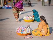 Bracelet sellers sitting on the floor (India)