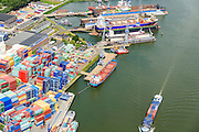 Nederland, Zuid-Holland, Rotterdam, 10-06-2015; Eemhaven met Seattleweg met depot voor verkoop en verhuur van containers en zeecontainers. In de achtergrond de drijvende dokken van Damen Shiprepair.<br /> Depot for sale and rental of containers and shipping containers.<br /> <br /> luchtfoto (toeslag op standard tarieven);<br /> aerial photo (additional fee required);<br /> copyright foto/photo Siebe Swart