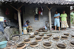 April 17, 2018 - Magelang, Centre Of Java, Indonesia - The old woman making a earthenware at home industry at Magelang, Center of Java, Indonesia. She earning around 60.000 IDR per day. (Credit Image: © Dadang Trimulyanto/Pacific Press via ZUMA Wire)