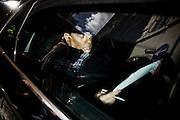 Silvio Berlusconi in auto prima della riunione dei gruppi parlamentari di Forza Italia nella sede del partito. Roma, 15 luglio 2014. Christian Mantuano / OneShot