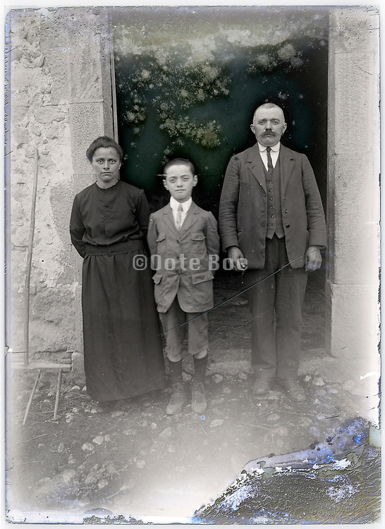 severely eroding glass plate with family portrait