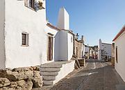 Historic cobbled street whitewashed buildings  walled hilltop village Monsaraz, Alto Alentejo, Portugal, southern Europe