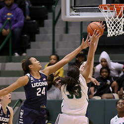 Feb 3, 2016; New Orleans, LA, USA; Connecticut Huskies guard/forward Napheesa Collier (24) blocks a shot by Tulane Green Wave guard Courtnie Latham (33) during the second quarter of a game at the Devlin Fieldhouse. Mandatory Credit: Derick E. Hingle-USA TODAY Sports