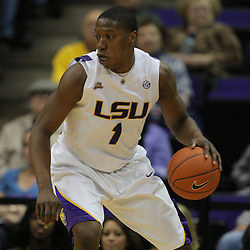 Jan 09, 2010; Baton Rouge, LA, USA; LSU Tigers forward Tasmin Mitchell (1) drives in with the ball against the Alabama Crimson Tide during the second half at the Pete Maravich Assembly Center. Alabama defeated LSU 66-49.  Mandatory Credit: Derick E. Hingle-US PRESSWIRE