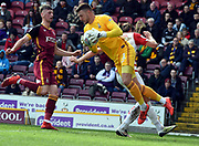 Richard O'Connell gets the ball before John Marquis during the EFL Sky Bet League 1 match between Bradford City and Doncaster Rovers at the Northern Commercials Stadium, Bradford, England on 6 April 2019.