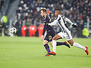 Christian Eriksen of Tottenham against Alex Sandro of Juventus during the Champions League Round of 16, leg 1 of 2 match between Juventus FC and Tottenham Hotspur at Juventus Stadium, Turin, Italy on 13 February 2018. Picture by Ahmad Morra