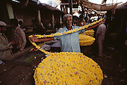 Flower vendor in public market in Mysore, South India.