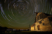 NEWS&GUIDE PHOTO / PRICE CHAMBERS.This composite image combines 16 time exposures to record the night sky above a barn near Mormon Row in Grand Teton National Park Thursday morning. The North Star, Polaris can be seen at the center of the star trails. The brightest star in the constellation Ursa Minor, it is actually six stars orbiting each other about 430 light years from Earth. Due to its nearly perfect alignment over the North Pole, it has helped people navigate for hundreds of years.