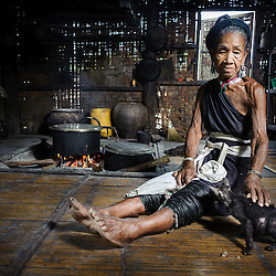 Portrait on an old Kayah woman with traditional attire in her house, Loikaw area, Myanmar, Asia