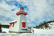 Lighthouse at edge of Georgian Bay<br /> Ppointe au Baril<br /> Ontario<br /> Canada
