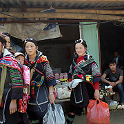 Black Hmong women in Lao chai village near Sapa, Northern Vietnam. Sapa and the surrounding highlands are close to the Chinese border in Northern Vietnam and is inhabited by highland minorities including Hmong and Dzao groups. Sapa is now a thriving tourist destination for travelers taking the night train from Hanoi. Sapa, Vietnam. 16th March 2012. Photo Tim Clayton