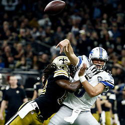 Dec 4, 2016; New Orleans, LA, USA; New Orleans Saints outside linebacker Dannell Ellerbe (59) hits Detroit Lions quarterback Matthew Stafford (9) as he throws during the second quarter of a game at the Mercedes-Benz Superdome. Mandatory Credit: Derick E. Hingle-USA TODAY Sports