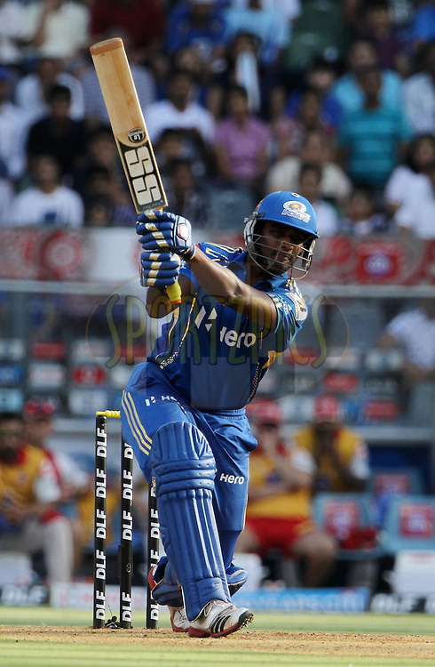 Mumbai Indian player Thisara Perera plays a shot during match 28 of the Indian Premier League ( IPL) 2012  between The Mumbai Indians and the Kings X1 Punjab held at the Wankhede Stadium in Mumbai on the 22nd April 2012..Photo by: Vipin Pawar/IPL/SPORTZPICS