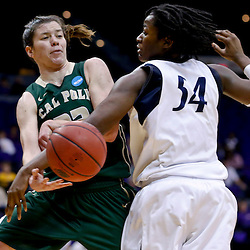 Mar 24, 2013; Baton Rouge, LA, USA; Cal Poly Mustangs guard Caroline Reeves (22) passes as Penn State Lady Lions forward/center Nikki Greene (54) defends in the first half during the first round of the 2013 NCAA womens basketball tournament at the Pete Maravich Assembly Center. Mandatory Credit: Derick E. Hingle-USA TODAY Sports