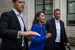 © Licensed to London News Pictures. 24/09/2019. London, UK. Gina Miller is escorted away from the Supreme Court in London by security after judges ruled that Prime Minister Boris Johnson's suspension of Parliament was unlawful. Photo credit: Rob Pinney/LNP