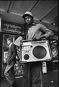 A teenager holding his ghetto blaster on 42nd street New York, USA, 1980